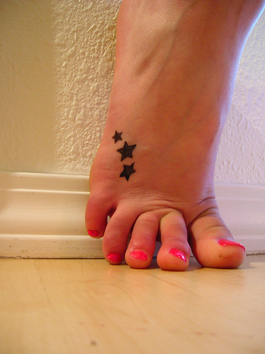 cross tattoos on foot for girls. For some unknown reason foot tattoos seem to be growing in popularity.